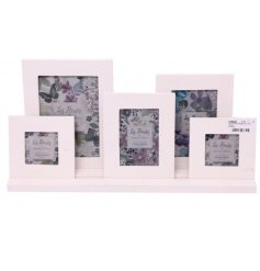 With its assortment of sizes, this set of frames on a tray will be sure to display your favorite pictured memories