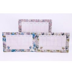 An assortment of magnetic Weekly Memoboards, each decorated with its own floral designs