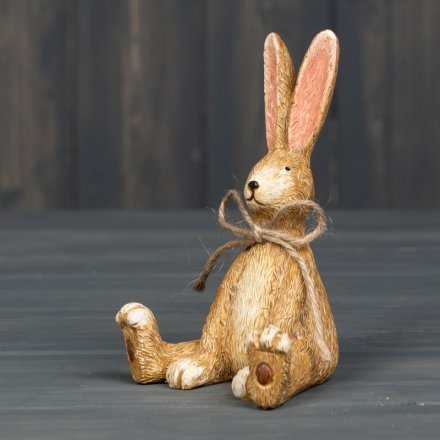 An utterly charming and beautifully detailed sitting rabbit decoration with jute string bow.