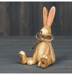 A charming Spring rabbit ornament with intricate detailing and a rustic jute string bow.