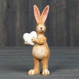 Stood holding a little love heart, this cute resin bunny decoration will be sure to add a spring touch to any home!