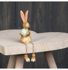 this cute resin bunny decoration will be sure to add a spring touch to any home!