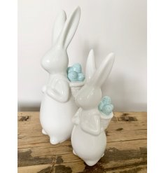 A chic Spring rabbit with a basket backpack full of pastel blue eggs.