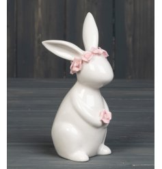 A pretty rabbit ornament adorned with a delicate pink floral crown. Complete with a single rose head.