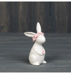 A charming rabbit ornament adorned with a pink floral crown.