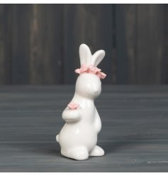 A charming Spring rabbit decoration adorned with delicate pink flowers.