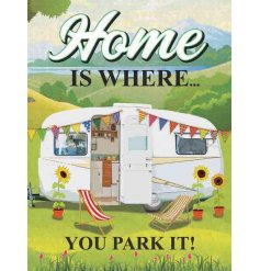 A large metal sign featuring a camper van decal and scripted 'Home is where you park it!' text