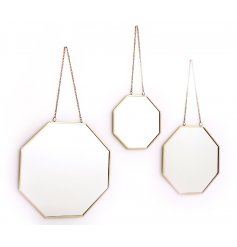 Sure to bring a trendy Geometric touch to your home interior, a set of 3 assorted sized mirrors with a gold tone