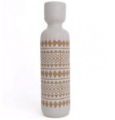 A large candle holder with a rough luxe aesthetic. Featuring an on trend aztec design in neutral colours.
