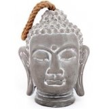 A large concrete buddha head with added white washed tones and a chunky rope handle