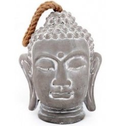A decorative concrete buddha head doorstop with an added chunky rope handle