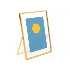 A sleek ands simple gold toned metal picture frame