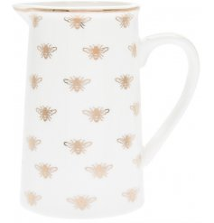 A sleek white fine china jug featuring a golden bee decorated design
