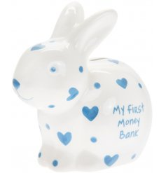 A sweet little ceramic bunny money box with added blue heart prints and a scripted text decal