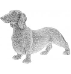 A sitting Dachshund ornament covered in sparkling diamonte accents