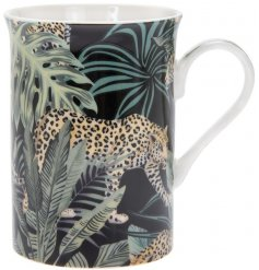A gorgeous on trend print made up of Jaguars and Palm Leaves, placed upon a Fine China Mug