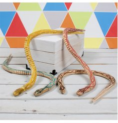 The Retro Games Wooden Snake is brightly painted with patterns that mimic natural scales