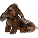 A sweet sitting faux leather sausage dog doorstop