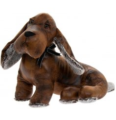 A sweet little sitting dachshund doorstop made from faux leather and fur fabrics