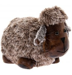 An adorably fuzzy faux fur covered sheep doorstop complete with added faux leather accents