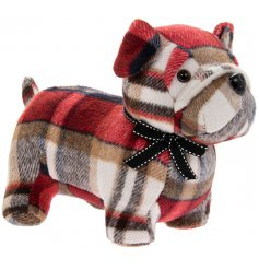 A sitting doggy doorstop made with a red tartan based faux suede fabric