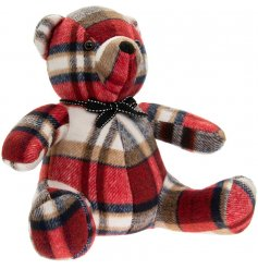 A sitting teddy doorstop made with a red tartan based faux suede fabric