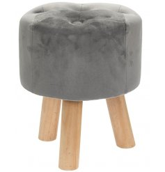 Stood on 3 natural wooden legs, this plush velvet grey stool also features a Luxury pin cushioned top for decoration