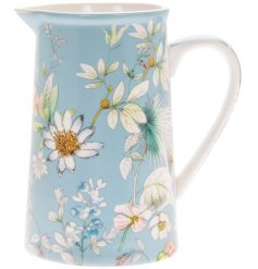 A blue toned jug featuring a beautiful 'Daisy Meadow' inspired decal