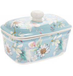 A blue toned butter dish featuring a beautiful 'Daisy Meadow' inspired decal
