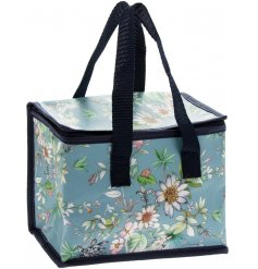 A blue toned fabric zip up lunch bag featuring a beautiful 'Daisy Meadow' inspired decal