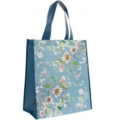 A blue toned fabric shopping bag featuring a beautiful 'Daisy Meadow' inspired decal