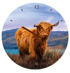 A grazing Highland Cow design perfectly printed onto a wall clock