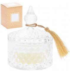 A beautiful diamond ridged glass candle pot, filled with a luxuriously scented Sticky Salted Caramel wax centre