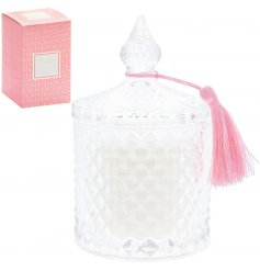 An elegant glass candle pot filled with a beautifully scented wax and placed in a Pink and Gold Geometric printed box