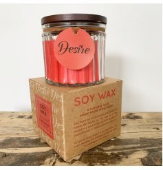 A traditional Cinnamon scented soy wax candle, set within a ridged glass pot