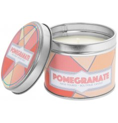 A small metal tin featuring a quirky pink patterned decal filled with a sweet and sumptuous Pomegranate scented wax