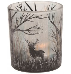 Set with its Winter Woodland inspired decals, this glass tlight holder also features a frosted pattern finish