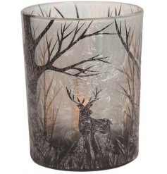 A gorgeously decorated tlight holder complete with a frosted inspired finish