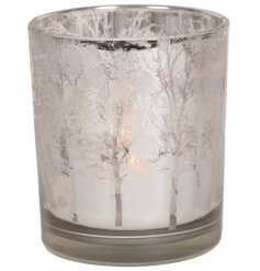 A gorgeously decorated tlight holder featuring a silver twig tree design