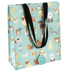 A light blue toned shopping bag that features extra string nylon handles and quirky dog doodle print on the outside