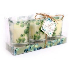 A set of 3 mini sized candle pots, each filled with a sweetly scented wax centre