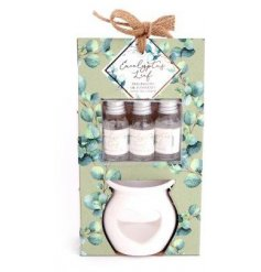 A pretty little ceramic oil burner complete with 3 scented essential oils