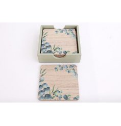 Wooden holder containing 6 wooden coasters, each printed with a design of Eucalyptus leaves.