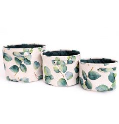 A set of 3 canvas storage basket decorated with a watercolour style eucalyptus leaf print.