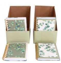 A6 notebook with green or white background, decorated with Eucalyptus leaf print.