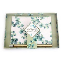 Gift set of A5 notepad decorated with Eucalyptus design and gold pencil, packaged in a gift box