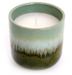Candle in glazed two tone green porcelain candle holder approx 9 x 9.5 cm tall