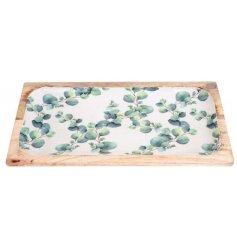 Eucalyptus design oblong wooden serving plate. Measures approx 40 x 19 cm