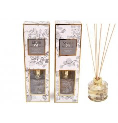 Classic gold reed diffuser, printed with skeletal foliage design. Available in Musk & Sandalwood or Amber & Patchouli