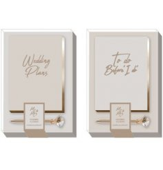 Wedding planner gift set containing bejewelled gold pen and white & gold notebook